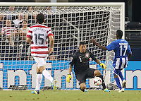 Michael Parkhurst #15 looks on as Nick Rimando #1 of the USMNT defends the goal from Marvin Chavez #17 of Honduras on July 24, 2013 at Dallas Cowboys Stadium in Arlington, TX. USMNT won 3-1.