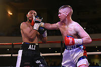 Mohammad Ali Malik (black/white shorts) defeats Paul Ducie during a Boxing Show at the Dunstable Conference Centre on 7th March 2020