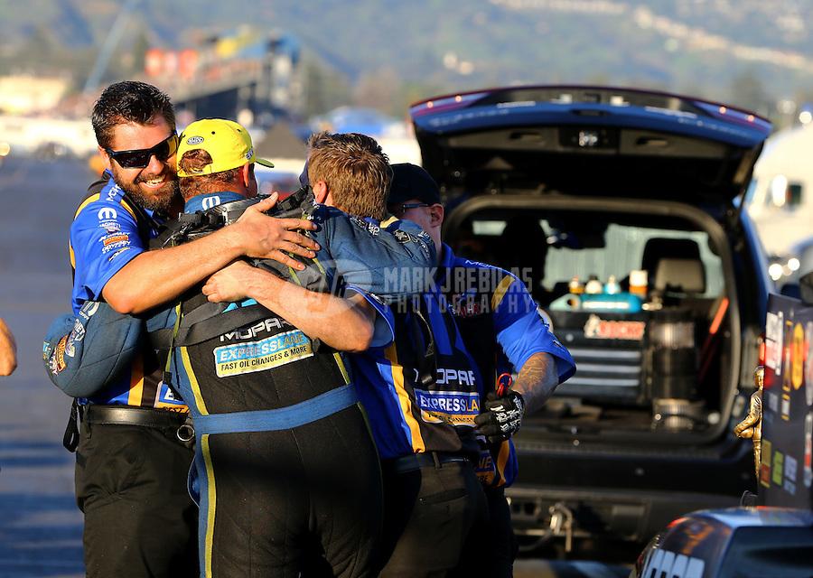 Feb 8, 2015; Pomona, CA, USA; NHRA funny car driver Matt Hagan celebrates with crew members after winning the Winternationals at Auto Club Raceway at Pomona. Mandatory Credit: Mark J. Rebilas-