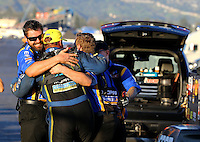 Feb 8, 2015; Pomona, CA, USA; NHRA funny car driver Matt Hagan celebrates with crew members after winning the Winternationals at Auto Club Raceway at Pomona. Mandatory Credit: Mark J. Rebilas-