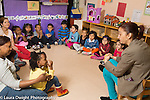 Education preschool 4-5 year ols circle time children listening to classmate and teacher, 12 children and 3 teachers all day program