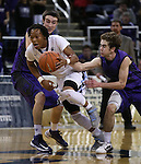 Canyon Springs' Chris Nelson drives through Spanish Springs defenders Jacob White, left, and Jake Longero during a Division I semi-final game in the NIAA basketball state tournament at Lawlor Events Center, in Reno, Nev., on Thursday, Feb. 27, 2014. Canyon Springs won 66-51. (Cathleen Allison/Las Vegas Review-Journal)