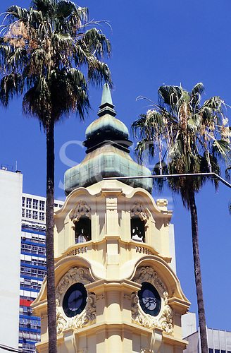 Porto Alegre, Rio Grande do Sul, Brazil. The old Correios e Telégrafos (Post and telegraph) office 1910 by German architect Theo Wiedersphan. Clock tower between palm trees; modern building in the background.