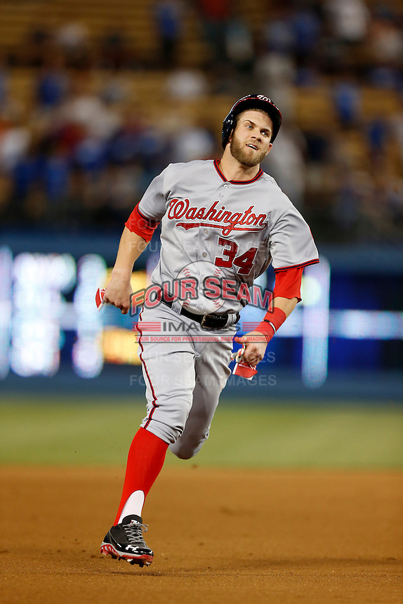 Bryce Harper #34 of the Washington Nationals runs the bases during a game against the Los Angeles Dodgers at Dodger Stadium on May 13, 2013 in Los Angeles, California. (Larry Goren/Four Seam Images)