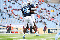 CHAPEL HILL, NC - OCTOBER 10: Javonte Williams #25 of North Carolina celebrates his second touchdown of the game with teammate Michael Carter #8 during a game between Virginia Tech and North Carolina at Kenan Memorial Stadium on October 10, 2020 in Chapel Hill, North Carolina.