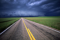 A shelf cloud from a severe thunderstorm travels down a desolate stretch of highway in western Nebraska.