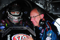 Apr. 27, 2012; Baytown, TX, USA: NHRA funny car driver Tony Pedregon (left) sits in his car talking to crew chief Mike Gueger during qualifying for the Spring Nationals at Royal Purple Raceway. Mandatory Credit: Mark J. Rebilas-