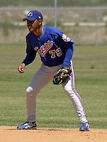 April 1, 2004:  Second baseman Maicer Izturis of the Montreal Expos (Washington Nationals) organization during Spring Training at Osceola County Stadium in Kissimmee, FL.  Photo copyright Mike Janes/Four Seam Images