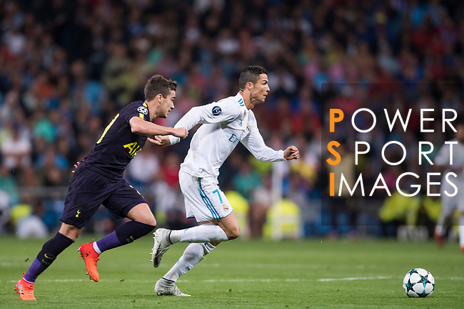 Cristiano Ronaldo of Real Madrid (R) fights for the ball with Harry Winks of Tottenham Hotspur FC (L) during the UEFA Champions League 2017-18 match between Real Madrid and Tottenham Hotspur FC at Estadio Santiago Bernabeu on 17 October 2017 in Madrid, Spain. Photo by Diego Gonzalez / Power Sport Images