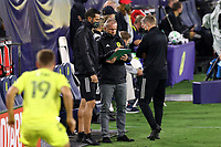 NASHVILLE, TN - SEPTEMBER 23: Head coach Gary Smith of Nashville SC consults with his assistant coaches Matt Pickens and Steve Guppy during a game between D.C. United and Nashville SC at Nissan Stadium on September 23, 2020 in Nashville, Tennessee.
