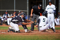 Seattle Mariners Johan Quevedo (35) tags out Rayder Ascanio (5) attempting to score a run during an instructional league intrasquad game on October 6, 2015 at the Peoria Sports Complex in Peoria, Arizona.  (Mike Janes/Four Seam Images)