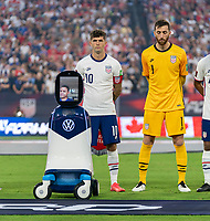 NASHVILLE, TN - SEPTEMBER 5: Christian Pulisic #10 of the United States stands on the field with CHAMP during a game between Canada and USMNT at Nissan Stadium on September 5, 2021 in Nashville, Tennessee.