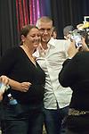 Actress Camryn Manheim gets her picture taken with Gus Hansen