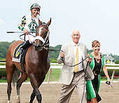 Dean and Patti Reeves lead Mucho Macho Man to the winner's circle.