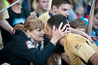 MELBOURNE, AUSTRALIA - DECEMBER 27: Labinot Haliti of the Jets shares a moment with a fan after the round 20 A-League match between the Melbourne Victory and the Newcastle Jets at AAMI Park on December 27, 2010 in Melbourne, Australia. (Photo by Sydney Low / Asterisk Images)
