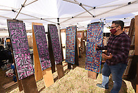 """CRAFTS BESIDE THE CREEK<br />David Gomez of Rogers talks about his painting technique at his booth on Wednesday Oct. 14 2020 at the 14th annual Spanker Creek Farm arts and crafts fair. The fair runs through Sunday at the farm on McNelly Road one-half mile east of U.S. 71 near Bentonville and Bella Vista. Admission is free. The """"It's Fall Y'all"""" crafts fair starts to day at the Benton County fairgrounds. Go to nwaonline.com/201015daily/ to see more photos.<br />(NWA Democrat-Gazette/Flip Putthoff"""