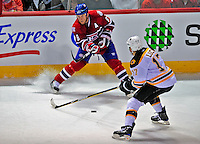 22 April 2009: Montreal Canadiens' defenseman Mike Komisarek keeps the puck away from Boston Bruins left wing forward Milan Lucic during the first period at the Bell Centre in Montreal, Quebec, Canada. The Bruins advanced to the Eastern Semi-Finals, eliminating the Canadiens from Stanley Cup competition with a 4-1 win and series sweep. ***** Editorial Sales Only ***** Mandatory Credit: Ed Wolfstein Photo