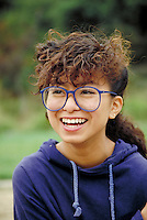 HISPANIC TEEN GIRL WEARING GLASSES. HISPANIC TEENAGER. SAN FRANCISCO CALIFORNIA USA.