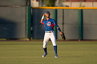 AZL Cubs 2 center fielder Jose Gonzalez (20) makes a throw to the infield during an Arizona League game against the AZL Reds at Sloan Park on June 18, 2018 in Mesa, Arizona. AZL Cubs 2 defeated the AZL Reds 4-3. (Zachary Lucy/Four Seam Images)