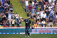 NZ's Daryl Mitchell celebrates making his 100th run off the final ball during the third One Day International cricket match between the New Zealand Black Caps and Bangladesh at the Basin reserve in Wellington, New Zealand on Friday, 26 March 2021. Photo: Dave Lintott / lintottphoto.co.nz