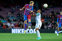 20th September 2021; Nou Camp, Barcelona, Spain; La Liga football league, FC Barcelona versus Granada CF;  Frenkie De Jong of FC Barcelona with a clearing header during the Liga match between FC Barcelona and Granada CF .