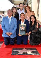 LOS ANGELES, CA. July 24, 2019: Kenny Ortega, Kathy Najimy, Gary Marsh, Jennifer Grey & Rana Gadban at the Hollywood Walk of Fame Star Ceremony honoring Kenny Ortega.<br /> Pictures: Paul Smith/Featureflash