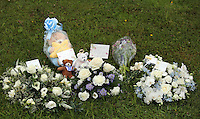Pictured: Flowers left after the burial at Thornhill Cemetery, Cardiff, Wales, UK. Tuesday 28 June 2016<br /> Re: The funeral of Sion, the baby boy found dead in the River Taff in Cardiff has taken place<br /> Generous locals raised nearly £1,400 for the memorial after reading about plans to hold a fitting ceremony for the newborn baby whose body was discovered in Cardiff a year ago.<br /> The funeral took place at the Briwnant Chapel at Thornhill Crematorium, Cardiff. Members of the public are invited to be among the congregation.