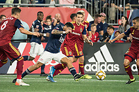 FOXBOROUGH, MA - SEPTEMBER 21: Gustavo Bao #7 of New England Revolution kicks the ball away from Aaron Herrera #22 of Real Salt Lake during a game between Real Salt Lake and New England Revolution at Gillette Stadium on September 21, 2019 in Foxborough, Massachusetts.