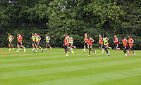 Pictured: Players warming up. Thursday 14 August 2014<br />
