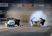 Nov 14, 2014; Pomona, CA, USA; NHRA funny car driver Jeff Diehl (left) races alongside Bob Bode during qualifying for the Auto Club Finals at Auto Club Raceway at Pomona. Mandatory Credit: Mark J. Rebilas-USA TODAY Sports