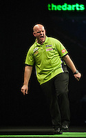21.05.2015. London, England. Betway Premier League Darts Play-Offs.  Michael van Gerwen [NED] celebrates a finish during his semi final game with Raymond van Barneveld [NED].  Michael van Gerwen [NED] won the match.