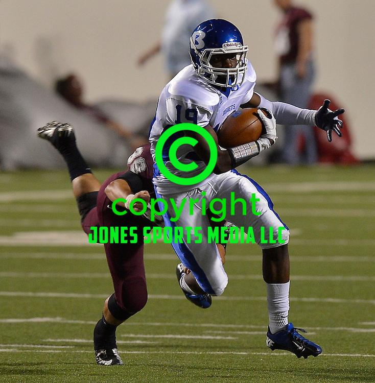 Bryant receiver Kylon Boyle (19) runs through a tackle by Benton's Zach Smiley during Friday night's Salt Bowl at War Memorial Stadium in Little Rock.<br /> <br /> Special to the Arkansas Democrat Gazette/Jimmy Jones