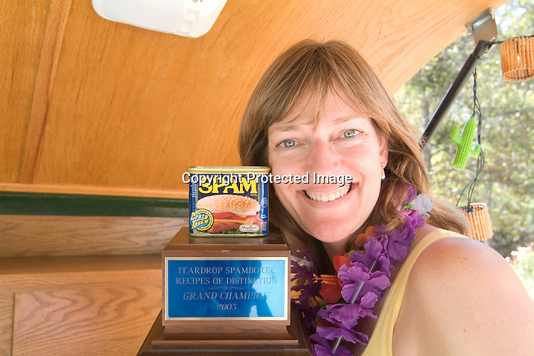Woman holding her Teardrop Spamboree Recipes of Distinction Grand Champion Trophy.