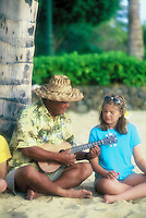 Local island man teaching young visitor girl the ukulele