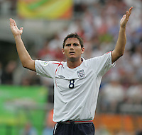 JUNE 15, 2006: Nuremberg, Germany: English midfielder (8) Frank Lampard shows his frustration to the referee in the second half. England defeated Trinidad & Tobago, 2-0, with two goals in the final seven minutes in their FIFA World Cup Group B match at Franken-Stadion.