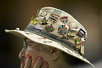 A Gwinnett Stripers usher wears a hat covered in baseball pins during the game against the Scranton/Wilkes-Barre RailRiders at Coolray Field on August 17, 2019 in Lawrenceville, Georgia. The Stripers defeated the RailRiders 8-7 in eleven innings. (Brian Westerholt/Four Seam Images)