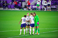 ORLANDO, FL - JANUARY 18: Crystal Dunn #19 of the USWNT, Abby Dahlkemper #7 of the USWNT, Becky Sauerbrunn #4 of the USWNT and Allysa Naeher #1 of the USWNT huddle before a game between Colombia and USWNT at Exploria Stadium on January 18, 2021 in Orlando, Florida.