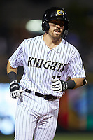 Danny Mendick (17) of the Charlotte Knights rounds the bases after hitting a home run against the Toledo Mud Hens at BB&T BallPark on April 25, 2019 in Charlotte, North Carolina. The Mud Hens defeated the Knights 11-7. (Brian Westerholt/Four Seam Images)