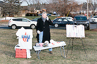 James Bragg, of Dallas, Tex., (center) sells buttons, shirts, hats, and other Cruz merchandise made by My Campaign Wear, before Texas senator and Republican presidential candidate Ted Cruz speaks at a Second Amendment Rally outside Granite State Indoor Range in Hudson, New Hampshire.