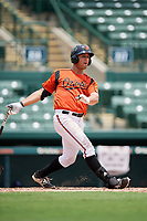 GCL Orioles first baseman J.C. Escarra (10) hits a double during a game against the GCL Rays on July 21, 2017 at Ed Smith Stadium in Sarasota, Florida.  GCL Orioles defeated the GCL Rays 9-0.  (Mike Janes/Four Seam Images)