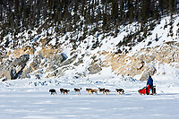 Middie Johnson runs on the Bering Sea ice as he leaves the Elim checkpoint during the 2010 Iditarod