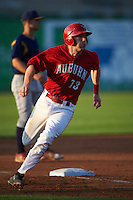 Auburn Doubledays catcher Erik VanMeetren (13) rounds third during a game against the State College Spikes on July 6, 2015 at Falcon Park in Auburn, New York.  State College defeated Auburn 9-7.  (Mike Janes/Four Seam Images)