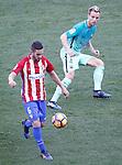 Atletico de Madrid's Koke Resurrecccion (l) and FC Barcelona's Ivan Rakitic during La Liga match. February 26,2017. (ALTERPHOTOS/Acero)