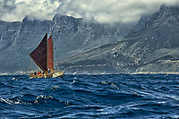 "Hawaiian voyaging canoe Hokule'a sails toward Cape Town, South Africa, with the Twelve Apostles (mountain peaks) in the distance, Thursday, November 12, 2015. Hokule'a was on a ""Malama Honua"" (Care for the Earth) worldwide voyage to raise awareness about the importance of protecting the world's oceans, considered the greatest environmental challenge of our time."