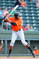 Outfielder Rafael Rodriguez (14) of the Augusta GreenJackets bats in a game against the Greenville Drive on Thursday, May 9, 2013, at Fluor Field at the West End in Greenville, South Carolina. Augusta won, 6-3. (Tom Priddy/Four Seam Images)