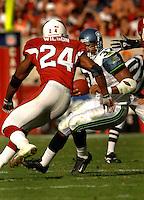 Nov. 6, 2005; Tempe, AZ, USA; Seattle Seahawks running back (37) Shaun Alexander tries to avoid safety (24) Adrian Wilson of the Arizona Cardinals at Sun Devil Stadium. Mandatory Credit: Mark J. Rebilas