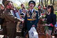Moscow, Russia, 09/05/2013..A 90 year old Russian World War Two veteran shouts the Russian military salute in Gorky Park during the country's annual Victory Day celebrations.