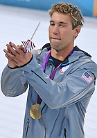 July 30, 2012..Matt Grevers catches a US Flag given to him by an spectator  as he walked around the pool after Medal cermony at the Aquatics Center on day three of 2012 Olympic Games in London, United Kingdom.