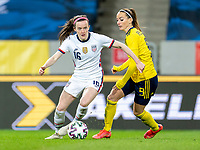 SOLNA, SWEDEN - APRIL 10: Rose Lavelle #16 of the USWNT dribbles past Kosovare Asllani #9 of Sweden during a game between Sweden and USWNT at Friends Arena on April 10, 2021 in Solna, Sweden.