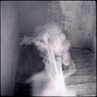 Multiple exposure of model in stairwell<br />